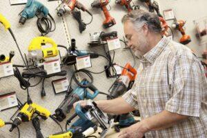 Man choosing a power drill